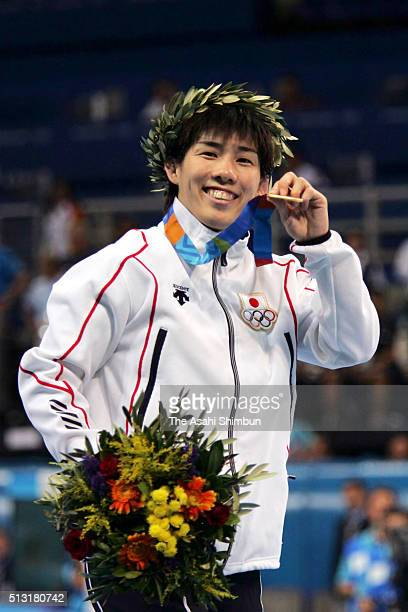 Gold medalist Saori Yoshida of Japan celebrates on the podium at the medal ceremony for the Wrestling Women's Freestyle -55kg final at the Ano...