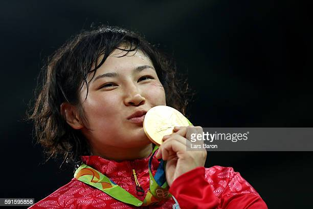 Gold medalist Sara Dosho of Japan stands on the podium during the medal ceremony for the Women's Freestyle 69kg event on Day 12 of the Rio 2016...