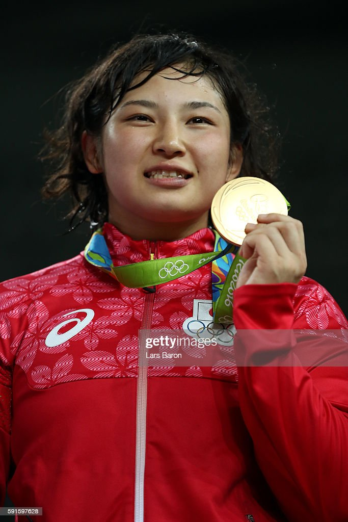 Gold medalist Sara Dosho of Japan stands on the podium during the medal ceremony for the Women's Freestyle 69kg event on Day 12 of the Rio 2016 Olympic Games at Caioca Arena 2 on August 17, 2016 in Rio de Janeiro, Brazil.