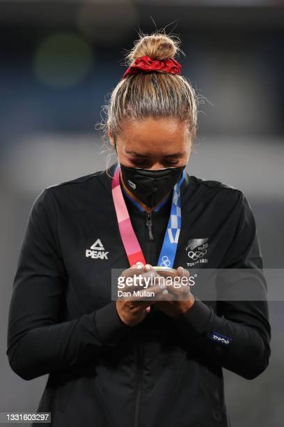 Gold medalist Sarah Hirini of Team New Zealand celebrates with her gold medal during the Women's Rugby Sevens Medal Ceremony on day eight of the...