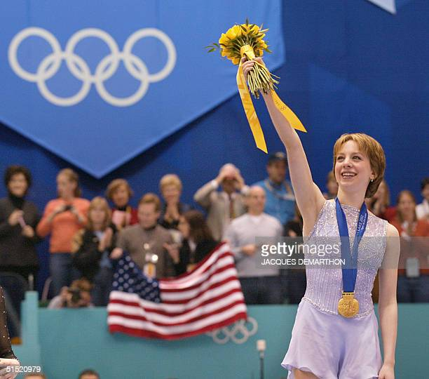 US gold medalist Sarah Hughes waves on the podium after the women's figure skating event at the Olympic Ice Center 21 February 2002 during the XIXth...