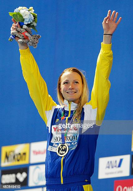 Gold medalist Sarah Sjostrom of Sweden poses during the medal ceremony for the Women's 100m Butterfly on day ten of the 16th FINA World Championships...