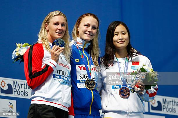 Gold medalist Sarah Sjostrom of Sweden poses with silver medalist Jeanette Ottesen of Denmark and bronze medalists Ying Lu of China during the medal...
