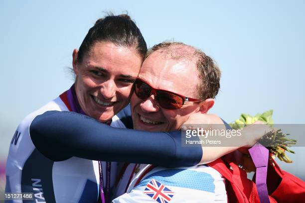 Gold medalist Sarah Storey of Great Britain celebrates with husband Barney Storey after winning the Women's Individual C5 Time Trial on on day 7 of...