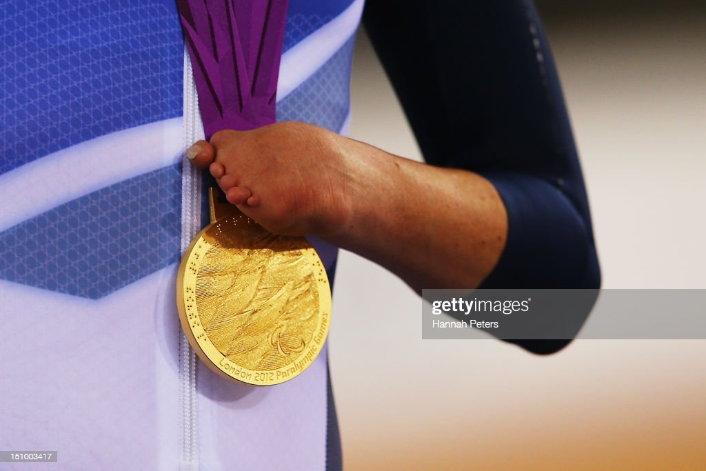 Gold medalist Sarah Storey of Great Britain holds her medal on the podium during the victory ceremony for the Women's Individual C5 Pursuit Cycling on day 1 of the London 2012 Paralympic Games at Velodrome on August 30, 2012 in London, England.