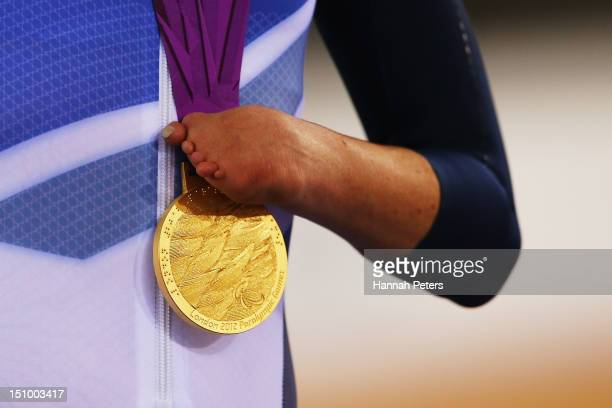 Gold medalist Sarah Storey of Great Britain holds her medal on the podium during the victory ceremony for the Women's Individual C5 Pursuit Cycling...