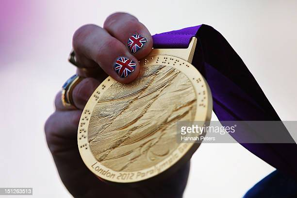Gold medalist Sarah Storey of Great Britain holds her medal up after competing in the Women's Individual Time Trial C5 on on day 7 of the London 2012...