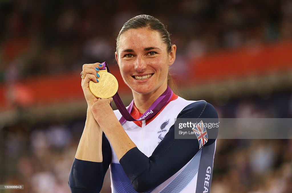 Gold medalist Sarah Storey of Great Britain poses on the podium during the victory ceremony for the Women's Individual C5 Pursuit Cycling on day 1 of the London 2012 Paralympic Games at Velodrome on August 30, 2012 in London, England.