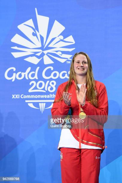 Gold medalist Sarah Vasey of England looks on during the medal ceremony for the Women's 50m Breaststroke Final on day two of the Gold Coast 2018...