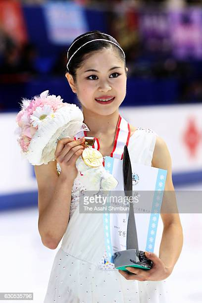 Gold medalist Satoko Miyahara poses for photogrpahs after the medal ceremony for the Women's Singles during day four of the 85th All Japan Figure...