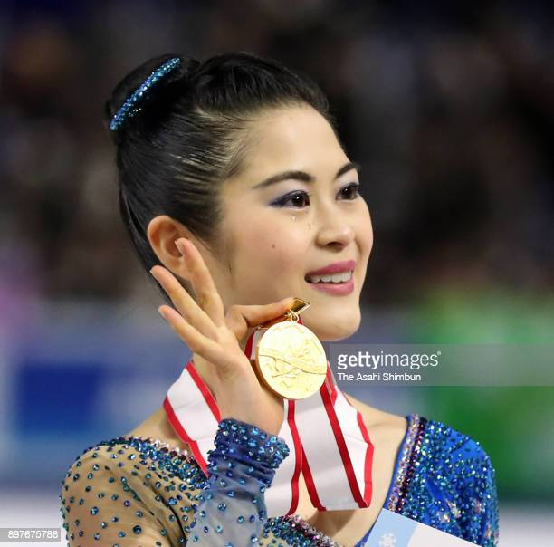 Gold medalist Satoko Miyahara poses on the podium at the medal ceremony for the ladies singles during day three of the 86th All Japan Figure Skating...