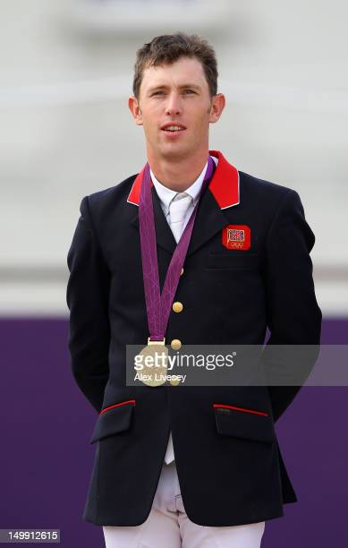 Gold medalist Scott Brash of Great Britain poses on the podium during the medal ceremony for the Team Jumping on Day 10 of the London 2012 Olympic...