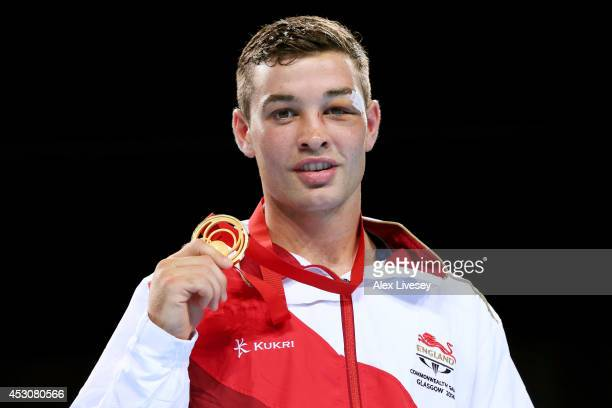 Gold medalist Scott Fitzgerald of England poses during the medal ceremony for the Men's Welter Final at SSE Hydro during day ten of the Glasgow 2014...