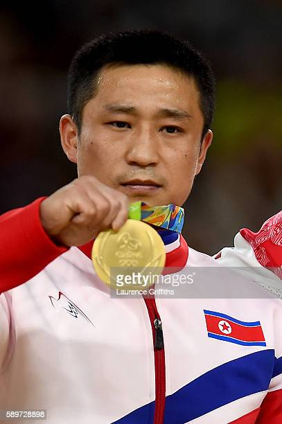 gold medalist Se Gwang Ri of North Korea poses for photographs on the podium at the medal ceremony for Men's Vault on day 10 of the Rio 2016 Olympic...