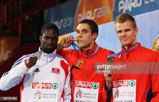 Gold medalist Sebastian Bayer of Germany poses with silver medalist Kafetien Gomis of France and bronze medalist Morten Jensen of Denmark after the...
