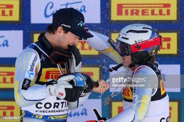 Gold medalist Sebastian Foss-Solevaag of Norway celebrates with bronze medalist Henrik Kristoffersen of Norway on the podium during the medal...