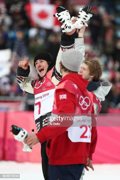 Gold medalist Sebastien Toutant of Canada and bronze medalist Billy Morgan of Great Britain celebrate during the victory ceremony after the Men's Big...