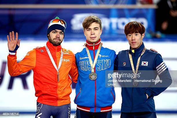 Gold medalist Semen Elistratov of Russia Silver medalist Sjinkie Knegt of the Netherlands and Sin DaWoon of Korea pose for a picture after winning...