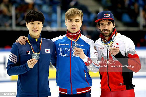 Gold medalist Semion Elistratov of Russia Silver medalist Seungsoo Han of Canada and Bronze medalist Charles Hamelin of Canada pose after winning the...