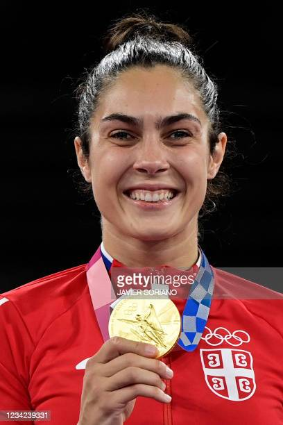 Gold medalist Serbia's Milica Mandic poses on the podium after the taekwondo women's +67kg bronze medal A bout during the Tokyo 2020 Olympic Games at...