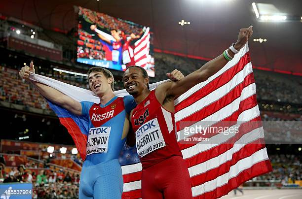 Gold medalist Sergey Shubenkov of Russia celebrates with bronze medalist Aries Merritt of the United States after the Men's 110 metres hurdles final...