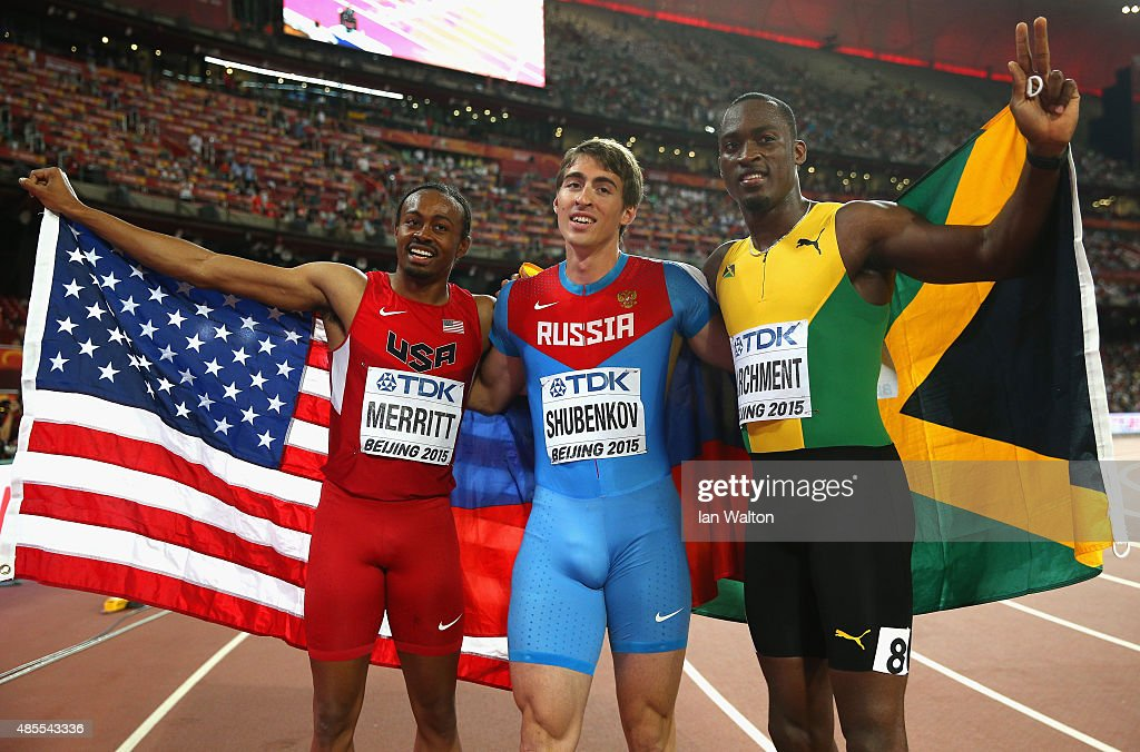 Gold medalist Sergey Shubenkov of Russia (C) celebrates with bronze medalist Aries Merritt of the United States (L) and silver medalist Hansle Parchment of Jamaica after the Men's 110 metres hurdles final during day seven of the 15th IAAF World Athletics Championships Beijing 2015 at Beijing National Stadium on August 28, 2015 in Beijing, China.