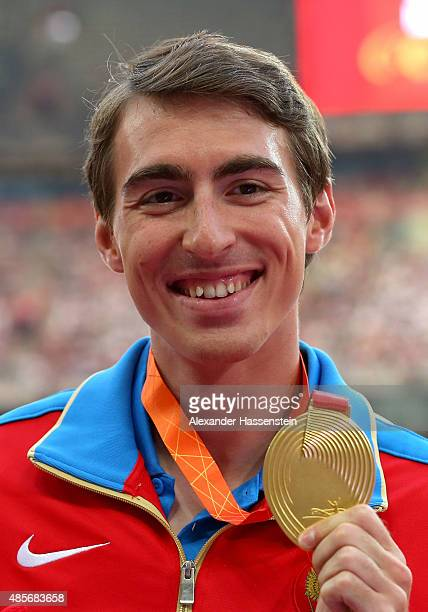 Gold medalist Sergey Shubenkov of Russia poses on the podium during the medal ceremony for the Men's 110 metres hurdles final during day eight of the...