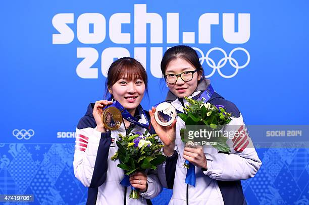 Gold medalist SeungHi Park of South Korea and bronze medalist Suk Hee Shim of South Korea celebrate during the medal ceremony for the Short Track...