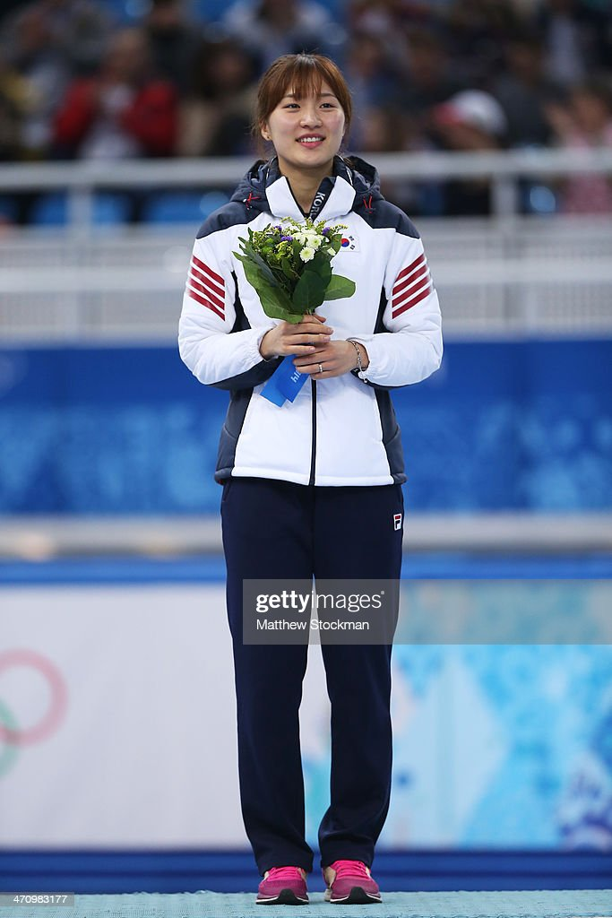 Gold medalist Seung-Hi Park of South Korea celebrates during the flower ceremony for the Short Track Women's 1000m on day fourteen of the 2014 Sochi Winter Olympics at Iceberg Skating Palace on February 21, 2014 in Sochi, Russia.