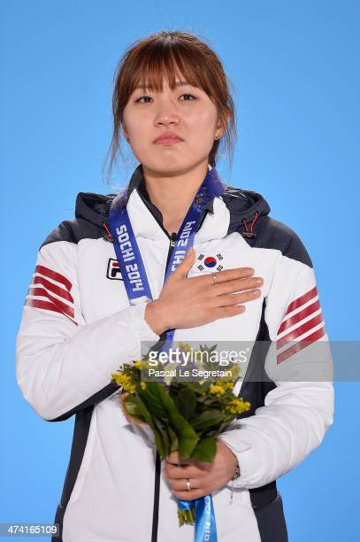 Gold medalist SeungHi Park of South Korea celebrates on the podium during the medal ceremony for the Short Track Women's 1000m on Day 15 of the Sochi...