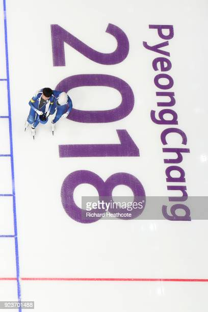 Gold medalist SeungHoon Lee of Korea skates with his arm around teammate Jaewon Chung of Korea during the Men's Speed Skating Mass Start Final on day...