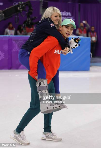 Gold medalist Shaolin Sandor Liu of Hungary celebrates with girlfriend Elise Christie of Great Britain following the Short Track Skating Men's 5000m...