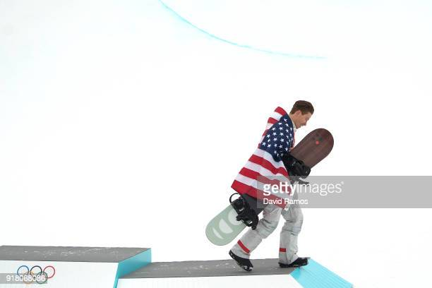 Gold medalist Shaun White of the United States goes down the podium during the victory ceremony for the Snowboard Men's Halfpipe Final on day five of...