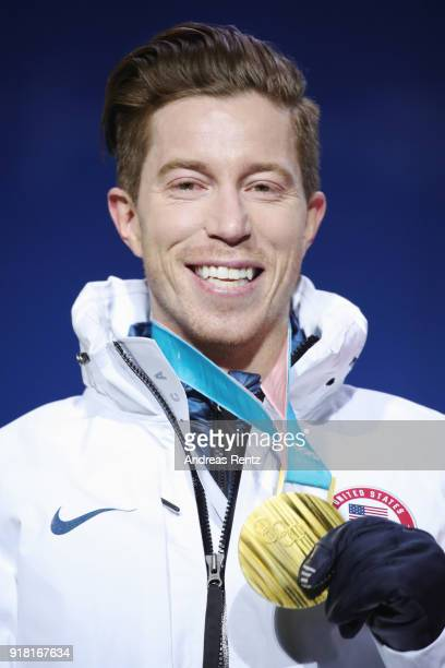 Gold medalist Shaun White of the United States poses during the medal ceremony for the Snowboard Men's Halfpipe Final on day five of the PyeongChang...