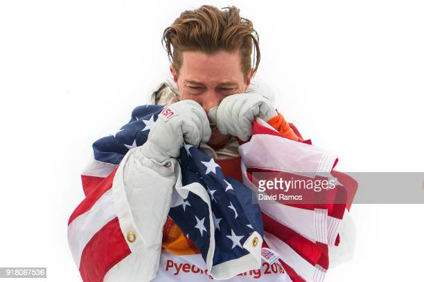 Gold medalist Shaun White of the United States shows his emotion during the victory ceremony for the Snowboard Men's Halfpipe Final on day five of...
