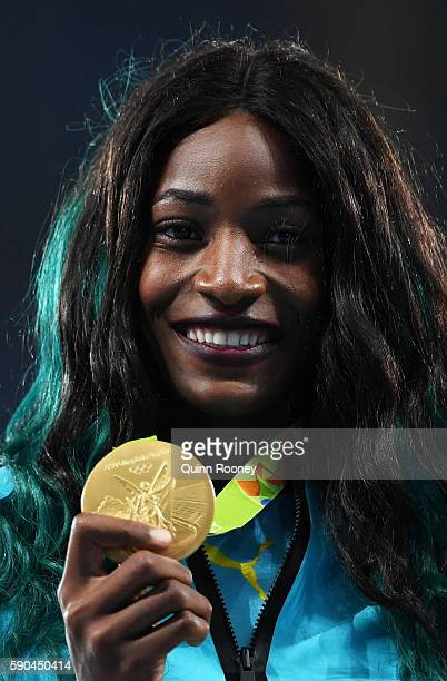 Gold medalist Shaunae Miller of the Bahamas poses during the medal ceremony for the Women's 400m Final on Day 11 of the Rio 2016 Olympic Games at the...
