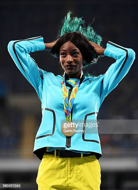 Gold medalist Shaunae Miller of the Bahamas reacts during the medal ceremony for the Women's 400m Final on Day 11 of the Rio 2016 Olympic Games at...