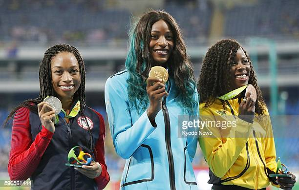 Gold medalist Shaunae Miller of the Bahamas silver medalist Allyson Felix of the United States and bronze medalist Shericka Jackson of Jamaica pose...