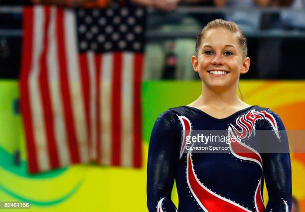 Gold medalist Shawn Johnson of the United States stands on the podium during the medal ceremony for the Women's Beam Final at the National Indoor...