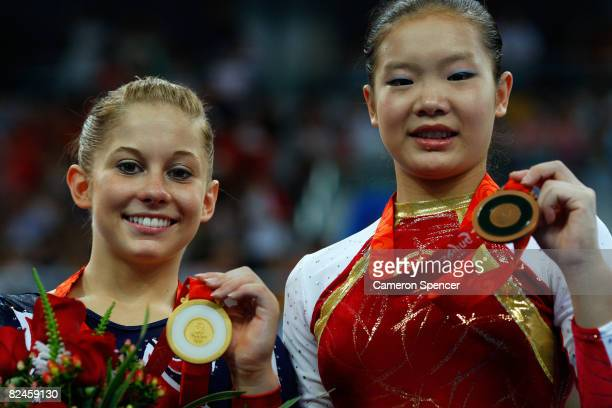 Gold medalist Shawn Johnson of the USA and bronze medalist Cheng Fei of China pose on the podium during the medal ceremony for the Women's Beam Final...