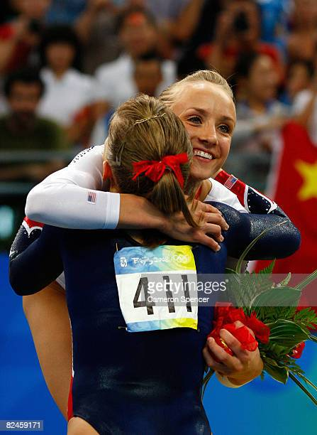 Gold medalist Shawn Johnson of the USA and silver medalist Nastia Liukin of the USA congratulate each other during the medal ceremony for the Women's...