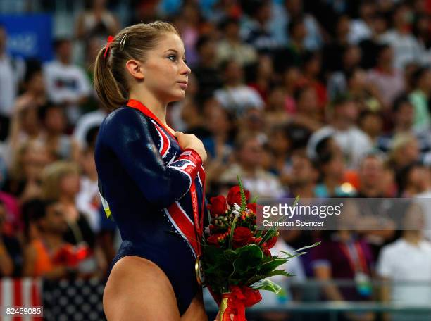Gold medalist Shawn Johnson of the USA listens to the national anthem from the podium during the medal ceremony for the Women's Beam Final at the...