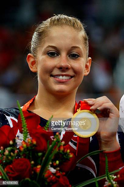 Gold medalist Shawn Johnson of the USA poses on the podium during the medal ceremony for the Women's Beam Final at the National Indoor Stadium on Day...