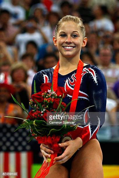 Gold medalist Shawn Johnson of the USA smiles as she stands on the podium during the medal ceremony for the Women's Beam Final at the National Indoor...