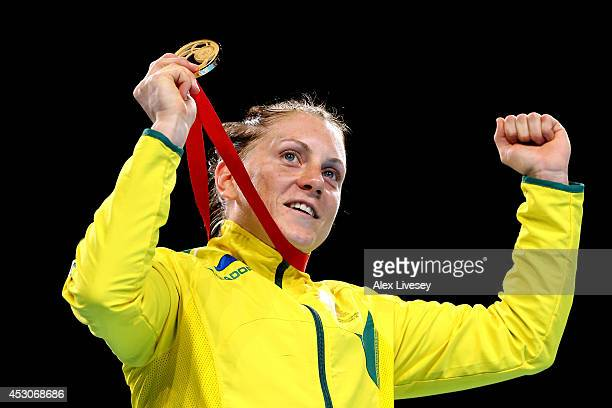 Gold medalist Shelley Watts of Australia celebrates during the medal ceremony for the Women's Light Final at SSE Hydro during day ten of the Glasgow...
