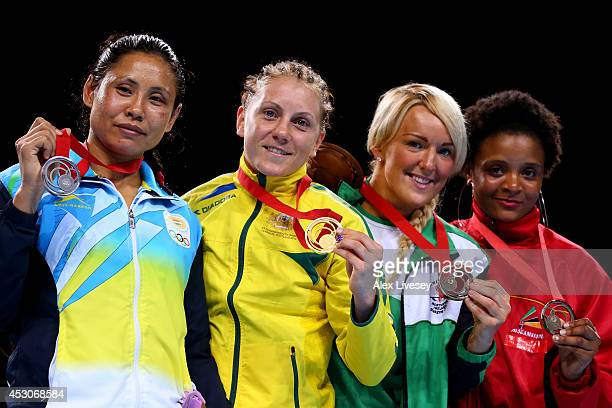 Gold medalist Shelley Watts of Australia poses with silver Laishram Devi of India and bronze medalists Alanna AudleyMurphy of Northern Ireland and...