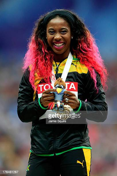Gold medalist Shelly-Ann Fraser-Pryce of Jamaica on the podium during the medal ceremony for the Women's 100 metres during Day Four of the 14th IAAF...