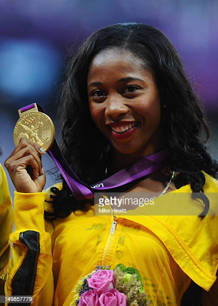 Gold medalist ShellyAnn FraserPryce of Jamaica poses on the podium for Women's 100m on Day 9 of the London 2012 Olympic Games at the Olympic Stadium...