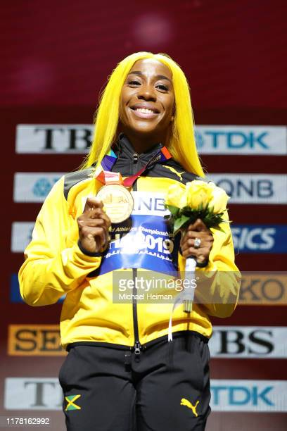 Gold medalist Shelly-Ann Fraser-Pryce of Jamaica stands on the podium during the medal ceremony for the Women's 100 Metres final during day four of...