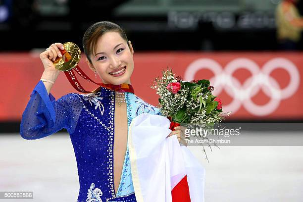 Gold medalist Shizuka Arakawa of Japan poses for photographs at the medal ceremony for the Figure Skating Women's Singles during day thirteen of the...